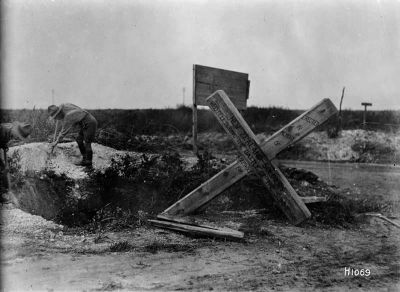 Soldiers erecting a cross remembering New Zealanders killed at the Battle of the Somme