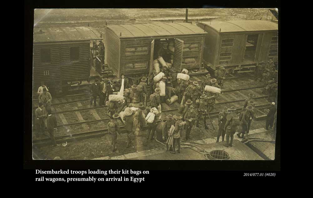 Disembarked troops loading their kit bags, presumably in Egypt