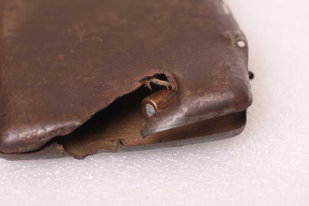Harold G Traves cigarette case and bullet