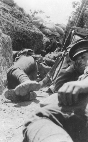New Zealand Soldiers resting in a trench