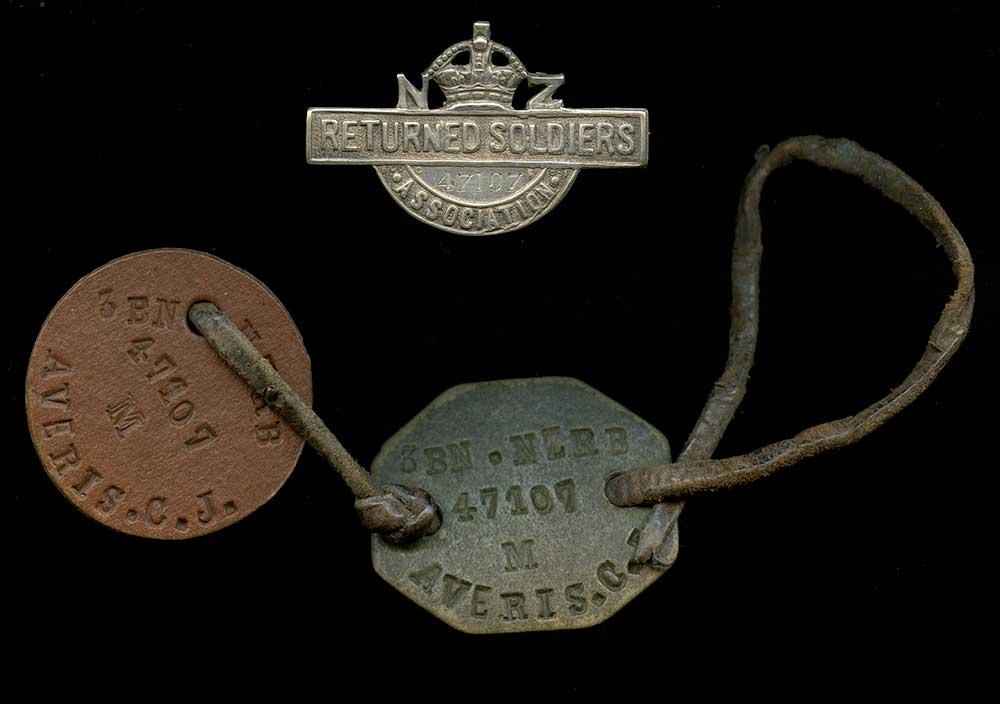 Dog tags and RSA badge belonging to Cecil Averis