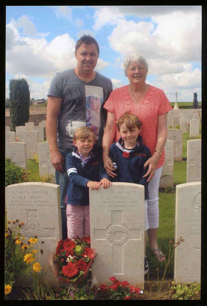 Fay Johnston and family visiting the grave of her grandfather Private Herbert Marshall, 2014