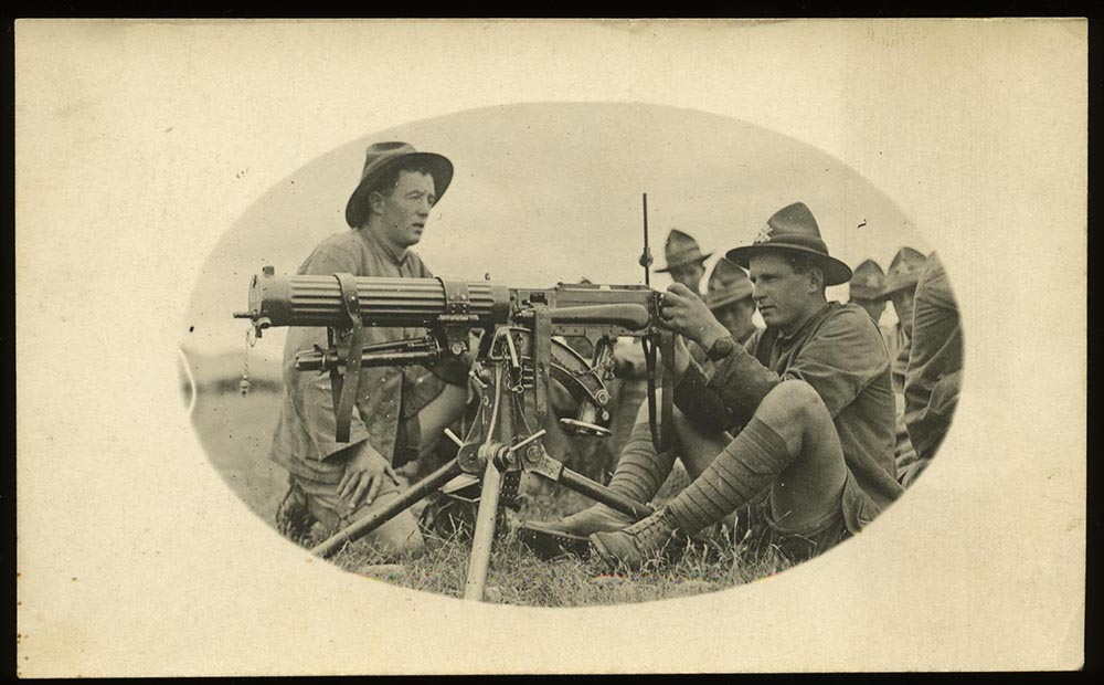 Godfrey (Toby) Burrows, posed behind the machine-gun, while training at Burnham Military Camp, circa 1918